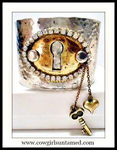 ON SALE VINTAGE STYLE Key N Heart Charm Rhinestone Hammered Metal Cuff  GREAT GIFT! Comes in a box.  www.cowgirlsuntamed.com #boutique #jewelry #bracelet #cuff #vintage #antique #silver #gold #locket #lock #key #rhinestone #cowgirl #western #junkgypsy #gift #fashion #onlineshopping