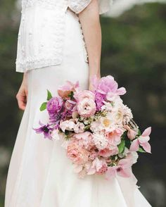 Purple Wedding Bouquets | Martha Stewart Weddings - The Nouveau Romantics created the bride's lavender, lilacs, sweet peas, clematis, and ranunculus bouquet.
