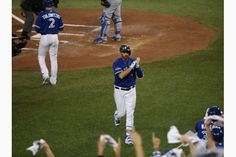 Chris Colabello of the Toronto Blue Jays celebrates after a second-inning home run off Royals starter Edinson Volquez (not pictured), to give the Blue Jays a 1-0 lead  early on. Oct 21, 2015