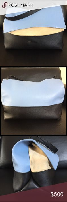 Celine leather and suede bag creams suede and blue and black leather. The cream has some dark marks on them and very slight signs of wear. Very light weight bag with plenty of room. Comes with original dust bag Celine Bags