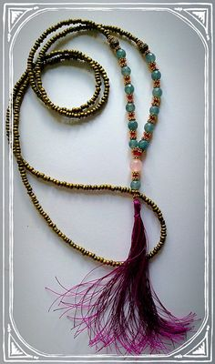 Brazilian Aquamarine & Hot Pink Statement Tassel Necklace by TheOliveTreeAtelier on Etsy https://www.etsy.com/listing/235398256/brazilian-aquamarine-hot-pink-statement