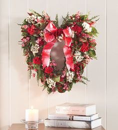 This wreath is so beautiful and inspires me to create a heart shaped wreath for my valentine celebration.