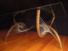 Really cool tension coffee table by Robby Cuthbert Designs - lots of great furniture and sculptures on his website!