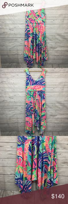 """Lilly Pulitzer sloane dress in exotic garden Great condition, only wore it once for a cruise. Rare. Pretty asymmetrical hem cut. Super flattering and stretchy material. 18.5"""" armpit to armpit unstretched and 43-53"""" long Lilly Pulitzer Dresses"""