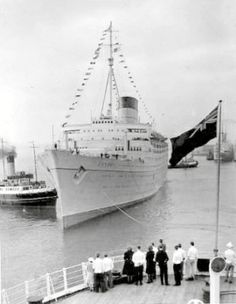 """RMS CARONIA making her maiden arrival in Southampton seen from the deck of the RMS AQUITANIA..AQUITANIA signaled to CARONIA """"Welcome Child"""" to which CARONIA responded """"Greetings Mother"""" CARONIA's response was apparently suggested by HRH Prince Phillip the Duke of Edinburgh,although it is not recorded for posterity"""