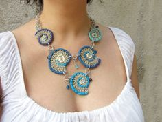 Crochet necklace,hemp necklace,cotton necklace,fiber necklace,boho necklace,folk necklace,gypsy necklace,nautilus necklace,shell necklace,vegan,summer,ethnic,blue,aqua,sea lovers,giada cortellini  A necklace made up of five crocheted shells in natural hemp twine and high quality cotton yarn in 5 different shades of blue decorated with various metal elements and crystals.  Aluminium chain and adjustable clasp.  100% Vegan, 100% cruelty free