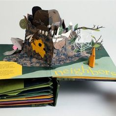 Welcome to the NeighborWood: A Pop-Up Book of Animal Architecture by Shawn Sheehy - The Neighbors. The book explores the ingenuity of nonhuman builders in terms of structural design, location choice, & material & tool use. Made of handmade, hand-dyed cotton/abaca paper & scraps of Tyvek. Covers are hand made from cotton. Type set digitally in Gill Sans & letterpress printed w/ magnesium plates. Preissig Roman was a template for cutting the titles.