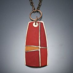 """Gorgeous reds and orange enamels in an abstract geometric pattern. Each piece is custom made in the studio. This hangs at a longer length on a 28"""" oxidized copper chain.The pendant itself is 3-1/4"""" x 1-1/2"""", if you include the circular element it hangs from, the hanging length comes to 4-1/8"""". - by Angela Gerhard Jewelry"""