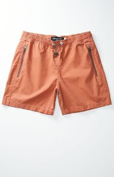Grab a solid and functional pair of trendy men's shorts from Modern Amusement. The Side Zip Volley Shorts offer freedom of movement thanks to the lightweight feel and elastic, bungee drawcord. All of your on the go storage needs are met with the zip back pocket and side zip front hand pockets. Solid volley shorts. Modern Amusement patch sewn on zip back pocket. Zip front pockets. Elastic waist, bungee drawstring. Machine washable. #youhabit #1hnWzTMF9