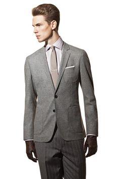 Men's Trend: Gray Matter  Boss' wool jacket, Ermenegildo Zegna's cotton shirt and wool pants. Alexander Olch tie; Tiffany & Co. tie bar; Imperial pocket square; Emporio Armani gloves.        Photo by Adam Gardiner