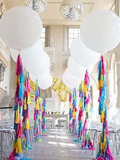 When we see balloons we instantly think of celebrations. Why not bring this party staple into your aisle decor? White looks elegant, but you could bring your wedding colours into play as well.    Photo via  Afloral Wedding Flowers and Decorations .