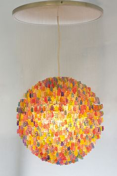 gummy bear pendant lamp. Artist Kevin Champeny recently designed this crazy chandelier made of 3,000 hand-cast acrylic gummy bears called the Candelier for home furnishings company Jellio. The light comes in two sizes, the largest of which actually uses 5,000 bears, is 31″ in diameter, and weighs in at about 50 lbs. Via laughing squid.