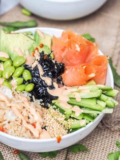 Sushi bowl with smoked salmon, avocado, cucumbers, edamame and rice makes for the perfect Japanese themed meal that is ready in under 30 minutes. All the flavors of a sushi roll but none of the fuss. Gluten Free and Dairy Free too. Smoked Salmon Sushi, Smoked Salmon Recipes, Salmon Avocado, Avocado Pesto, Gluten Free Recipes For Lunch, Healthy Recipes, Healthy Meals, Asian Recipes, Vegan Meals