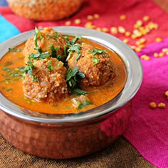 Lentil balls soaked in a rich tomato coconut gravy, simply delicious and irresistible