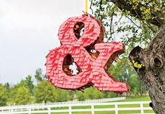 An ampersand piñata - a classic & elegant symbol to  represent your union. Source: theknot.com #piñatas #reception