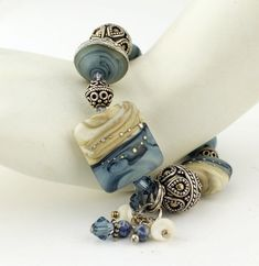 Handmade lampwork glass beads in my denim style are accented with light denim blue Swarovski crystals, tiny Iolite gemstones and Bali
