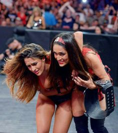 Charlotte and Becky Lynch aims to send a message to the Divas locker room against Divas Champion Nikki Bella and Alicia Fox on Raw. The Bella Twins, Nikki Bella Photos, Bella Sisters, Nikki And Brie Bella, Daniel Bryan Brie Bella, Brie Bella Wwe, Daniel Bryan Wwe, Nxt Divas, Total Divas