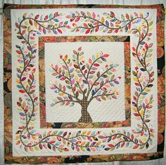 Leaves of Spring  Letitia Chung of San Francisco, California  37.5 x 37.5  Hand appliquéd, hand quilted, original design  great vining border!!