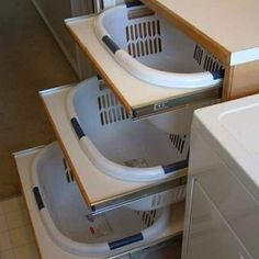 Organizing Laundry This isn't a chest of drawers, it's a nifty chest of laundry baskets! Baskets slide out on rails for sorting, and then slide back neatly when not in use. Top it off with a homemade ironing board countertop to maximize efficiency.