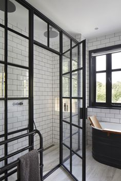 Monchrome bath with critical shower screen and door. Black towel rail and black Vola sanitary ware. simple, contemporary and elegant solution to a family bathroom Black Towel Rail, Black Towels, Bathroom Inspiration, Bathroom Ideas, Architects London, Residential Architect, Shower Screen, Family Bathroom, White Bathroom