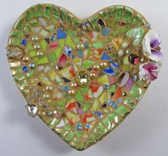 Heart-shaped Butterfly Bath. Fill with sugar water and set on a porch or deck table.