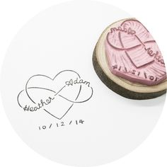 """have a custom stamp made like this one from""""this is just to say"""" stamps  http://www.weddingchicks.com/2014/01/28/handmade-rubber-stamp-for-infinite-love/"""