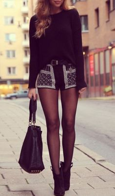 Tights paired with winter shorts and ankle boots