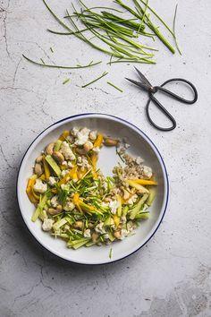 salad based on pearl barley porridge, mango, raw cauliflower and cashew.