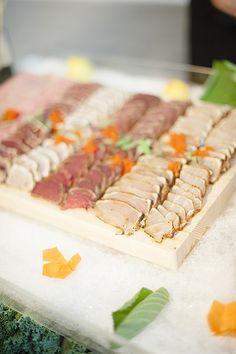 Sushi bar for a wedding cocktail hour | Melissa Schollaert Photography | Brides.com