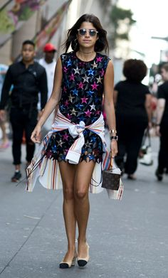 The Best New York Fashion Week Street Style of Fall 2015 - Leandra Medine of 'The Man Repeller' wearing a metallic star cut-out mini dress and a striped button-down shirt tied at the waist