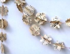 Extra Long Waltz With Me:Vintage Music Paper Garland Classical Music embossed fl from CollectingFeathers Nicole Zupanovich | Blue Caravan Ethical Design Market
