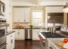 """The Perimeter Countertops are 3cm Polished Ceasarstone Piatra Gray and the Island Countertop is a 3cm Polished Super White Marble.  The kitchen sink is by Kraus (KBU-14) and the faucet is the """"Parq Deck-mount Polished Chrome Kitchen Bridge Faucet"""""""