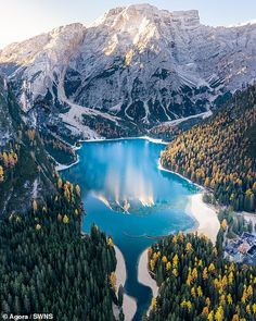 'Autumn in the Dolomites' by shows Lago di Braies a bright blue mountain lake. Landscape Photos, Landscape Photography, Nature Photography, Mountain Photography, Photography Competitions, Photography Contests, Mountains In Italy, Teton Mountains, Siargao Island