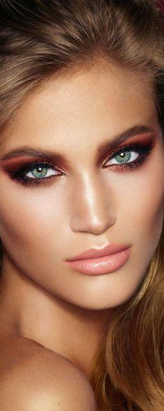 Flawless skin, dramatic pink eyes and natural lip.