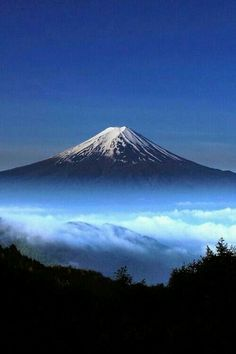"Rising above the clouds, Mount Fuji, Japan. Fuji-san has long been a sacred mountain. Japanese Buddhists believe the mountain is the gateway to a different world. Mount Fuji, Mount Tate, and Mount Haku are Japan's ""Three Holy Mountains. Monte Fuji, Places Around The World, Around The Worlds, Beautiful World, Beautiful Places, Amazing Places, Beautiful Scenery, Mount Fuji Japan, Amazing Nature"