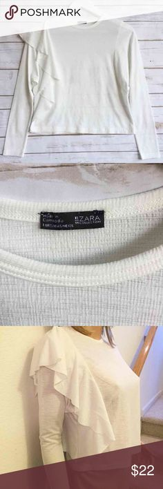 """ZARA Light White Top w/ Side Ruffle ZARA Light White Top w/ Side Ruffle  Black & White ZARA Collection Small Adorable!!! 17"""" bust 20"""" length  No fabric tag - assuming primarily nylon fabric with some rayon or acrylic. Light and stretchy.  Thank you for looking and please check out the rest of my closet. Zara Tops Blouses"""