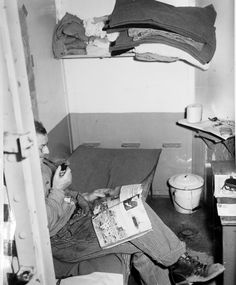 An inmate reads in his cell at the Utah State Prison in 1943. This was when the prison stood at what is now Sugar House Park.