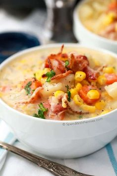 A bowl of corn chowder with potatoes and bacon