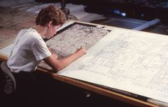 A geographer reviews a 1980 Census map of Fountain Valley, CA.  In 1980, Fountain Valley's population was 55,080.  Its estimated population in 2014 was 57,010.