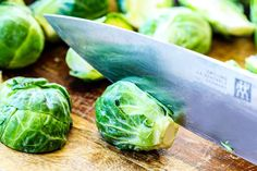 showing how to trim Brussels Sprouts on a cutting board by slicing sprout in half Balsamic Brussel Sprouts, Roasted Sprouts, Healthy Meal Prep, Healthy Eating, Healthy Recipes, Yummy Recipes, Healthy Food, Yummy Food, Recipes