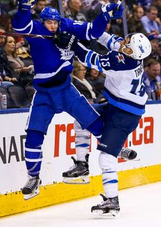 Brandon Tanev of the Winnipeg Jets checks Mitch Marner of the Toronto Maple Leafs during the third period at the Air Canada Centre on March 2018 in Toronto, Ontario, Canada. Jets Hockey, Hockey Teams, Hockey Stuff, Mitch Marner, Maple Leafs Hockey, Air Canada Centre, Toronto Photography, Ice Hockey Players, Nhl Games