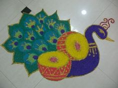 Peacock rangoli designs are popular due to it's colors, vibrant feathers and beautiful shapes. Latest Peacock rangoli designs for all festivals. Best Rangoli Design, Rangoli Designs Latest, Mehndi Designs, Designs Rangoli, Peacock Rangoli, Kolam Rangoli, Diwali Festival Of Lights, Rangoli Colours, Rangoli Ideas