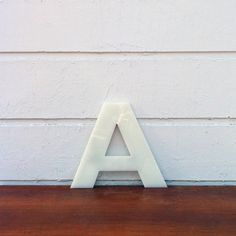 Amazing, weighty letter R. Fantastic as a wall hanging or ornamental piece. Measures 460mm in height and 25mm thick.