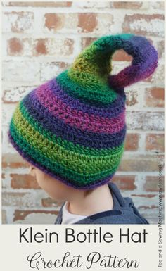 A free Klein bottle hat crochet pattern. The hat is worked entirely in trebles so grows nice and quickly! The perfect hat for anybody who loves maths!