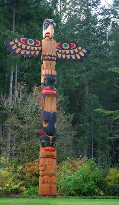 Totem  pole - I'd love to have a pair of these on either side of the driveway to my dream log cabin.