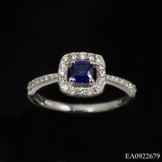 This sapphire and diamond cluster ring comprises of a single .36ct, cushion cut sapphire, claw set and suspended in the centre of a delicate round cut diamond border. Additional graduated round cut diamonds set into the narrow, tapered shank make this a delightful piece of jewellery. £1050