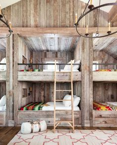 This bunk bed room may fit a ton of guests to this cabin, but it also has a cozy feel thanks to functional built-ins and wrought-iron railing. Instead of traditional twin- size bunk beds, the homeowners decided to build six queen-size versions. The room also contains two twin beds, bringing the sleeping total in this space alone to 14 people. Talk about a slumber party!