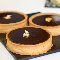 Classic French dessert- chocolate tarts sprinkled with gold leaf