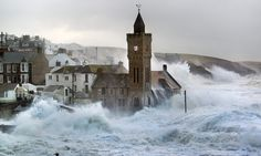 monster wave hits Porthleven - check out the water coming from the roof.