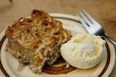 square of Trinidad cassava pone on a plate with scoop of homemade no-churn coconut ice cream